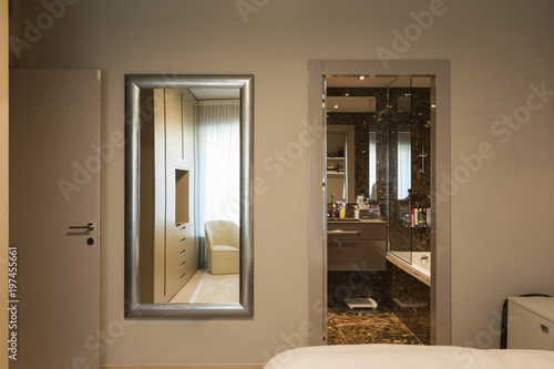 Elegant bedroom with wardrobe - 197455661