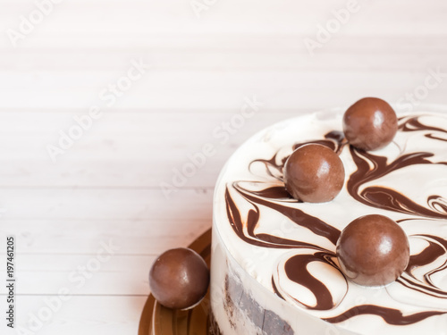 Delicious easy ice cream cake with chocolate on a light