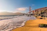 Golden Gate Bridge at sunset seen from the  beach in San Francisco, California.  - 197462467