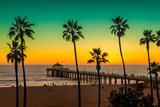 Manhattan Beach with Palm trees and pier at sunset in Los Angeles, California. Vintage processed. Fashion travel and tropical beach concept.