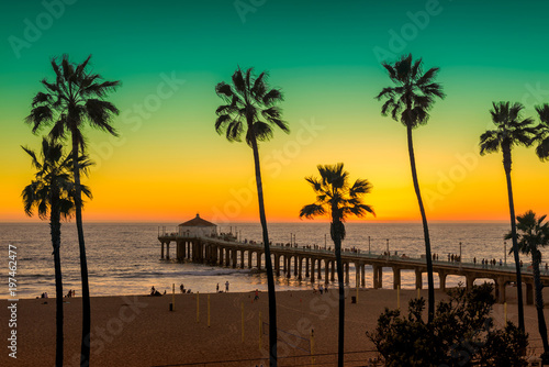 Foto Spatwand Strand Manhattan Beach with Palm trees and pier at sunset in Los Angeles, California. Vintage processed. Fashion travel and tropical beach concept.