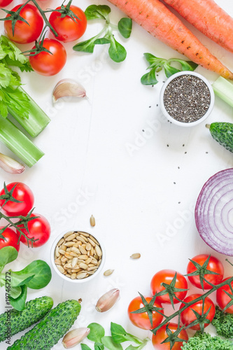 Foto Murales Top view of fresh vegetables over white background. Healthy and organic food frame. Flat lay.