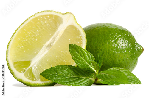one lime with half of a juicy lime with leaves of mint isolated on white background - 197482493
