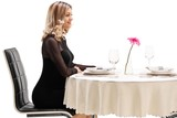 Young woman sitting at a restaurant table - 197486403