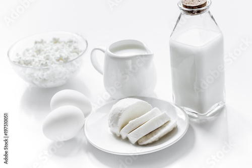 Healthy food concept with milk and cottage cheese on white table - 197510051