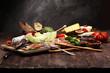 Italian antipasti wine snacks set. Cheese variety, Mediterranean olives, pickles, Prosciutto di Parma with melon, salami.