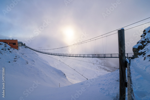 Long steel bridge on the top of a mountain in the alps