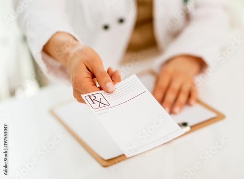 Plexiglas Apotheek Closeup on medical doctor woman giving prescription