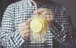 a man drinking fresh drink home made lemonade froma jar mug