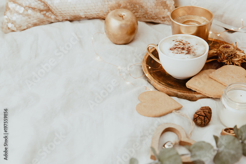 Good Morning. Cozy Still Life background with coffee cup and cookies on bed