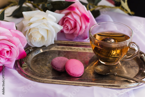 Pink Macaroons Hot Tea On Silver Vintage Tray Blurred Roses Background