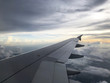 beautiful view from the window of the plane on the clouds and the wing of the aircraft