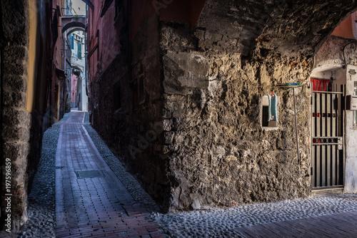 Plexiglas Smalle straatjes The narrow and dark streets of the Italian city of Ventimiglia