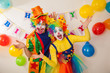 Clowns are a boy and a girl in bright costumes at the child's birthday. The explosion of emotions and the fun of the circus