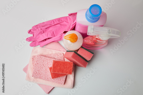 high angle view of domestic supplies for spring cleaning on white surface