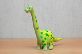 Brachiosaurus dinosaurs toy on wooden table.