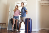 Couple Arriving At Summer Vacation Rental - 197628255