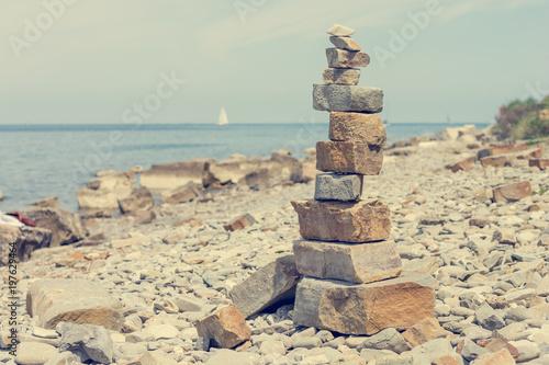 Foto op Canvas Zen Pebbles zen tower at sea shore.