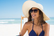 Quadro Happy woman with straw hat at beach