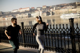 Healthy runners running in  city cityscape background