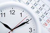 clock face and calendar sheet with numbers