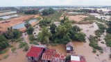 Aerial drone shot ; fly backwards over flooding along the river inundated rural houses and agricultural fields - 197694258