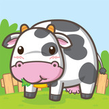 Cute cow is eating grass