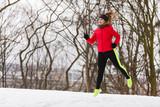 Woman wearing sportswear exercising during winter