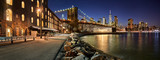 Brooklyn Bridge Park waterfront in evening with view of skyscrapers of Lower Manhattan and the Brooklyn Bridge. Brooklyn, Manhattan, New York City - 197757831