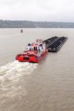 Tugboat Pushing a Heavy Barge - 197775266