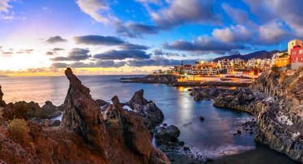 Puerto de Santiago city, Tenerife, Canary island, Spain: Beautiful sunset view of Puerto de Santiago over the rocks and water
