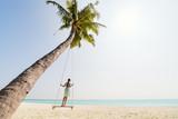 Adorable girl swinging