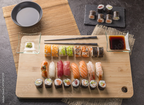 Foto op Plexiglas Sushi bar Sushi Set sashimi and sushi rolls served on stone slate