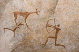 a drawing of an ancient hunt on the wall of a cave of ocher. history. archeology. - 197809227