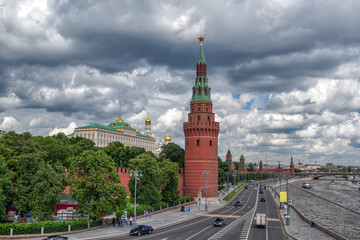 view of the Moscow Kremlin and embankment of the river in cloudy weather