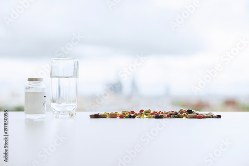 Blurry white tabletop with pills - 197850056
