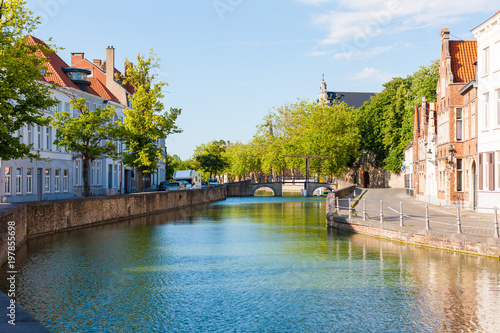 Foto op Canvas Brugge Langerei Canal leading away from centre of Bruges, Brugge, Belgium