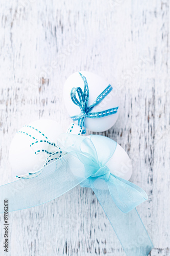 White Easter Eggs with Blue Ribbons