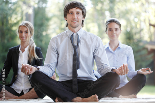 Business people practicing yoga