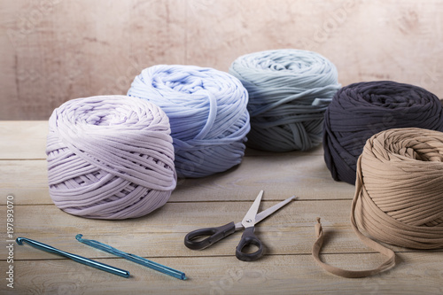Colorful  knitting wool and knitting needles on wooden background