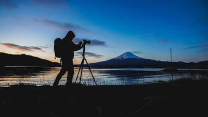Silhouette Of Photographer Taking Photo At Mount Fuji