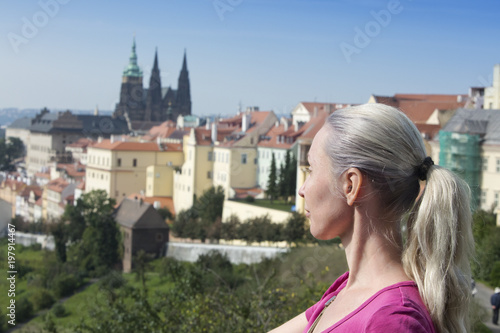 The woman the tourist on a beautiful background of the old city, Prague...