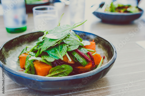 healthy salad dish with sweet potato beetroot and spinach
