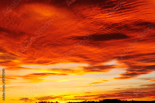 Fotobehang Rood traf. An amazing Sunset and cloud formation over the market town of Hucknall in the English county of Nottinghamshire in the UK.