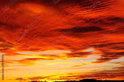 Plexiglas Rood traf. An amazing Sunset and cloud formation over the market town of Hucknall in the English county of Nottinghamshire in the UK.