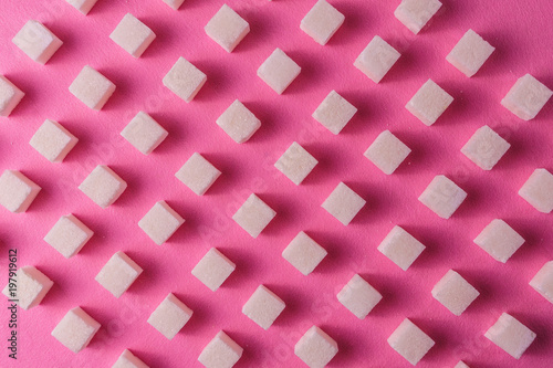 Food background with sugar on pink color paper. - 197919612