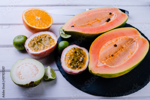 Foto Murales tropical exotic  fruits papaya,  guava, orange, passion on white background