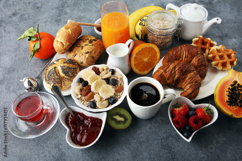 Breakfast served with coffee, orange juice, croissants and fruits. Balanced diet. - 197934451