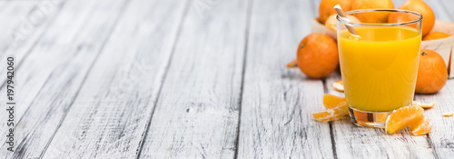 Homemade Tangerine Juice on a wooden table (selective focus) - 197942060