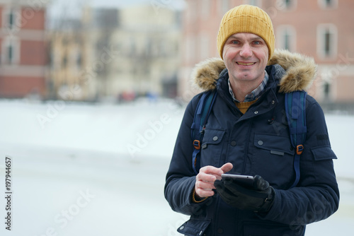 Man with a tablet outdoors